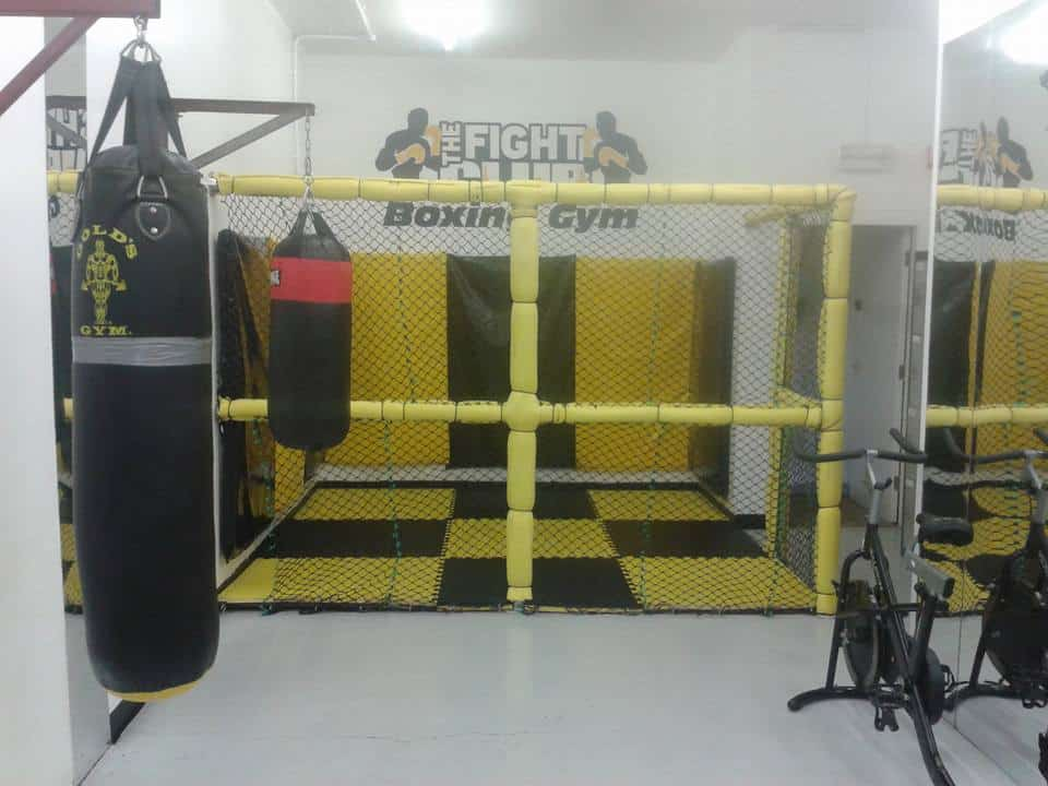 gym with punch bags and equipment