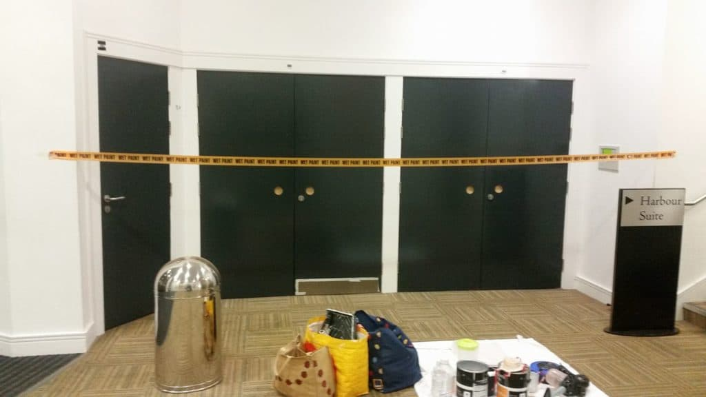 painted doors at Bridlington Spa with wet paint sign