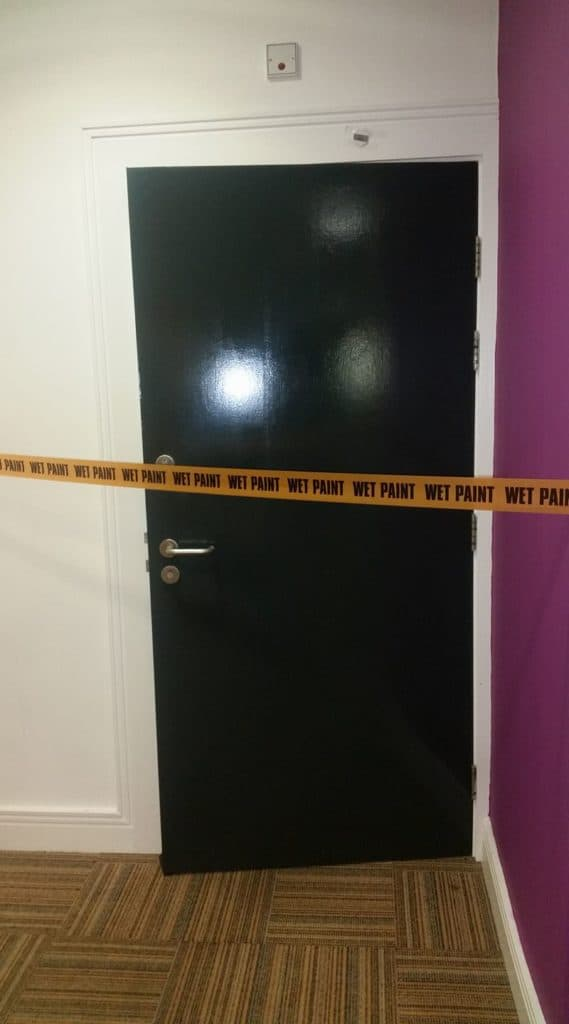 painted door at Bridlington Spa with wet paint sign