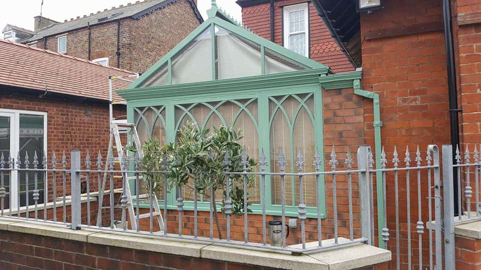 outside of conservatory with ladder