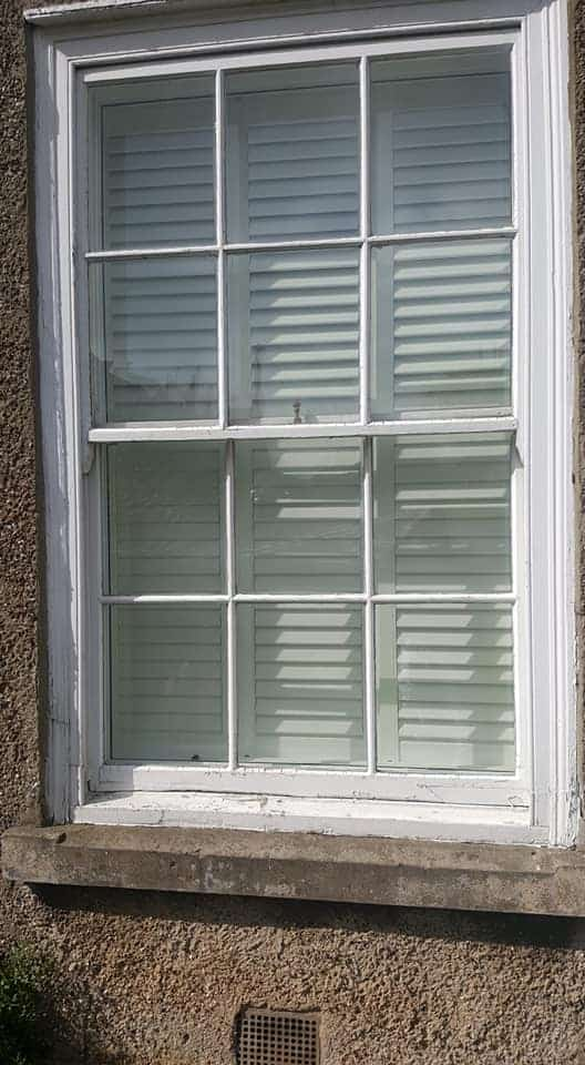 window frame with peeling paint