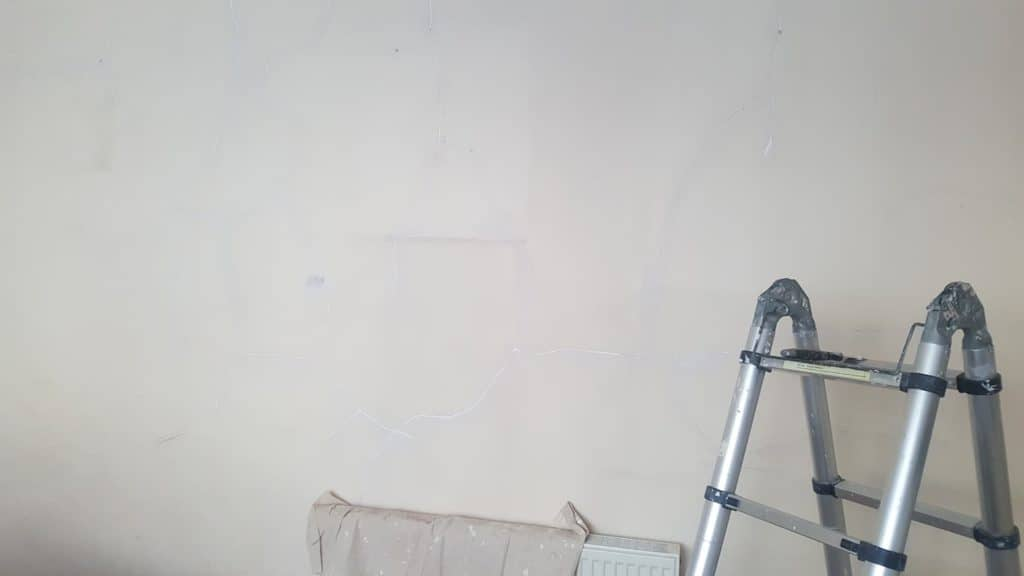 internal house wall with filled plaster cracks