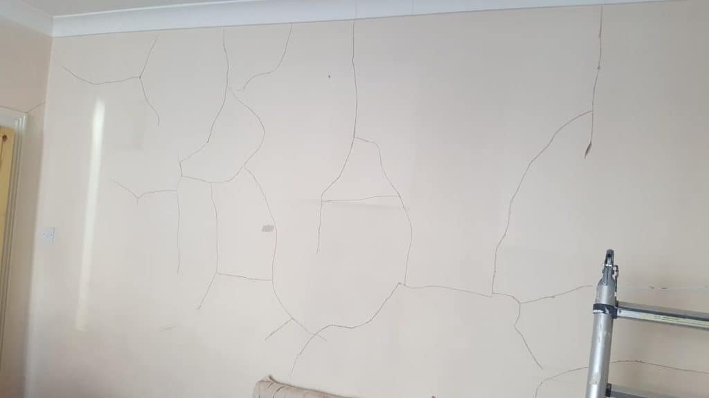 internal house wall with plaster cracks